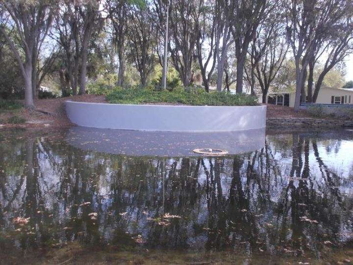 After Repainting of a pond retaining wall in Edgewater, FL